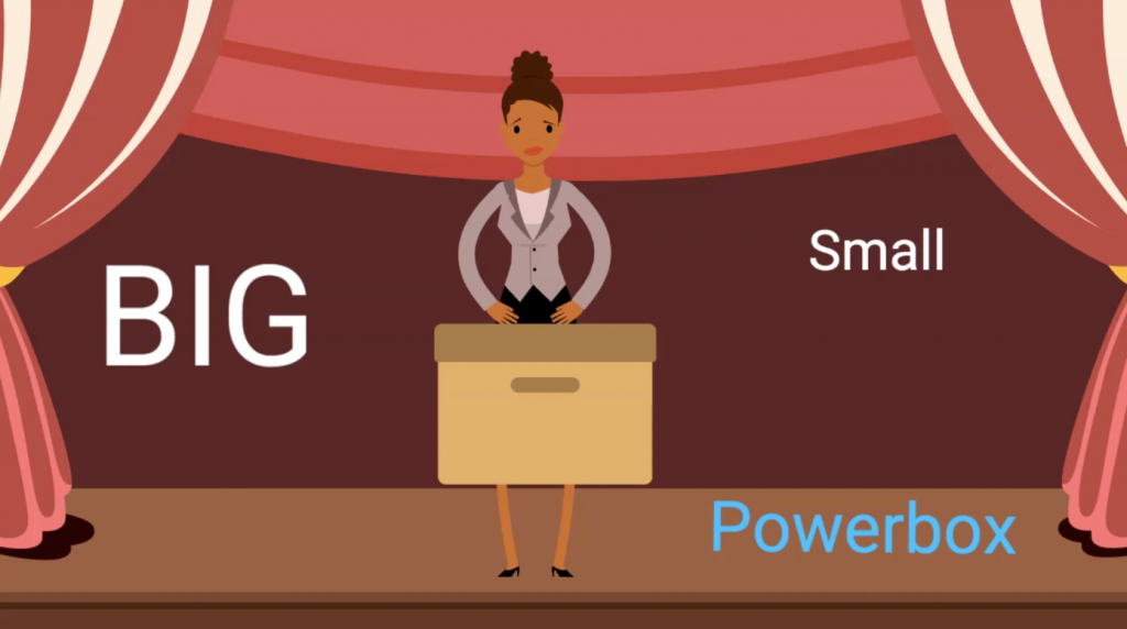 Cartoon of a woman on stage with a box with words Big, Small and Powerbox